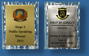 Gold and silver plaques with school logo