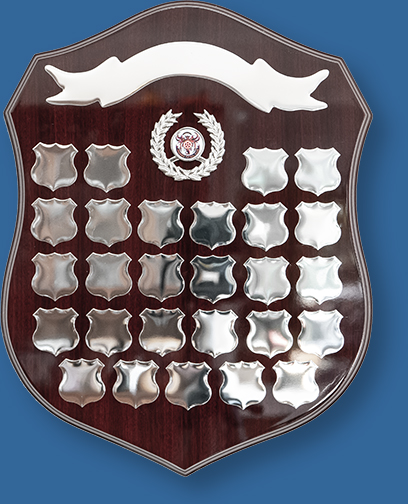 Perpetual woodgrain shield with silver plates