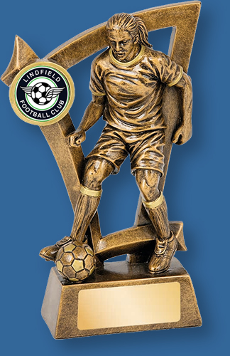 Bronze tone soccer female trophy. Detail dribbling the ball.