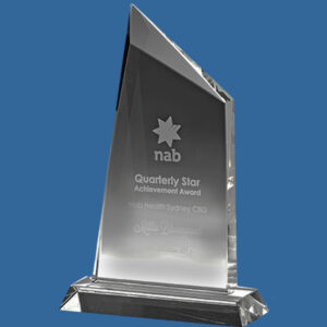 Beautiful crystal clear Crystal Award. Single peak to the left hand side with bevelled facets to the edges.