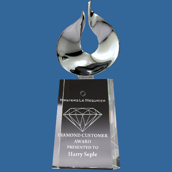 Crystal Clear freestanding Crystal Trophy featuring aesthetic fan shaped chrome design on the top of the crystal award