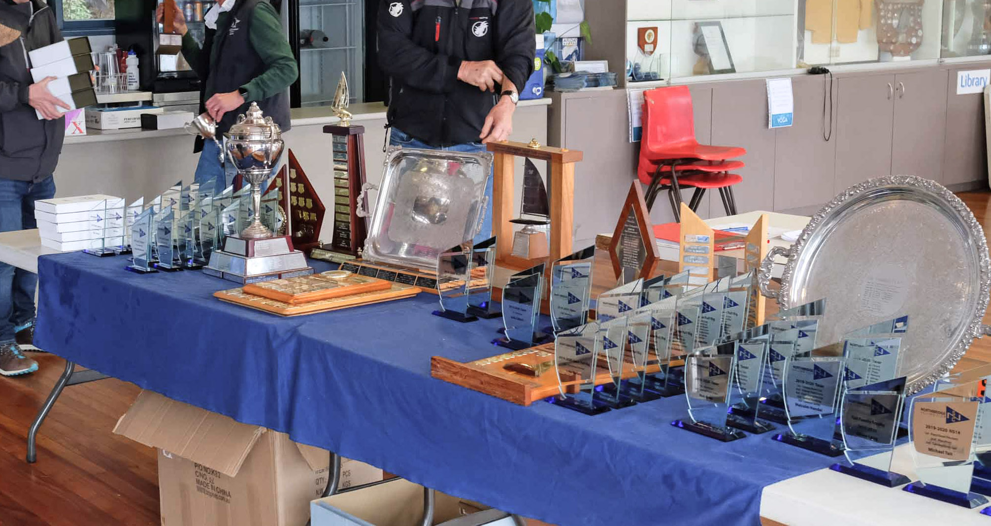 Glass Trophies and Awards on a presentation Table for a Sailing Club