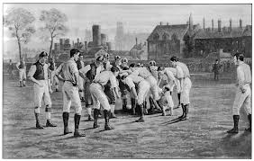 Playing with knee length pants late 19th century rugby playesrs showing wing forward standing off the scrum formation